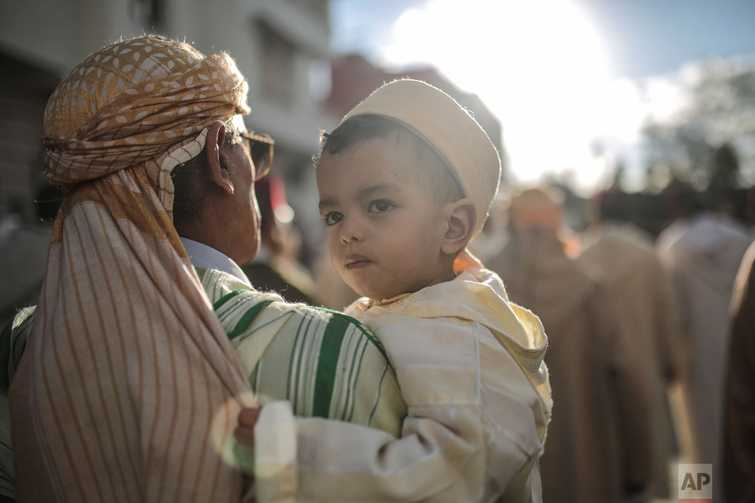 In this Thursday Nov. 30, 2017 photo, people take part in an annual parade celebrating the birth anniversary of Prophet Muhammad, in Sale, near Rabat, Morocco. A large parade with historic roots takes place in the Moroccan city of Sale each year to mark the birth of Prophet Muhammad, an occasion Muslims around the world observe as Mawlid an-Nabi. (AP Photo/Mosa'ab Elshamy)