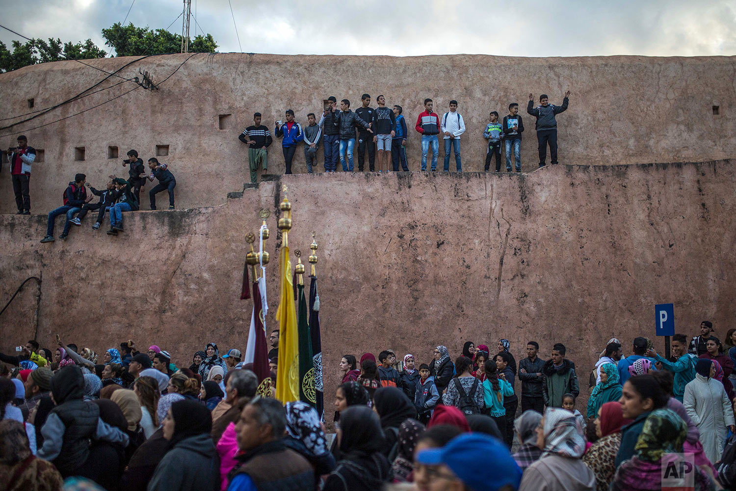 In this Thursday Nov. 30, 2017 photo, people take part in an annual parade celebrating the birth anniversary of Prophet Muhammad, in Sale, near Rabat, Morocco. (AP Photo/Mosa'ab Elshamy)