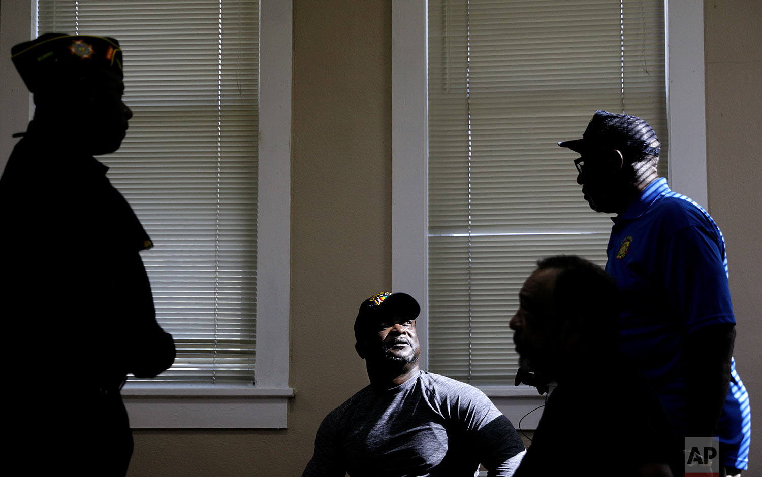 """U.S. Army Gulf War veteran Robert Tolbert, center, who supports the protests of kneeling during the national anthem, speaks with fellow veterans at a Veterans of Foreign Wars meeting in Lumberton, N.C., Saturday, Oct. 28, 2017. """"Everybody's mad at each other because everybody's got their opinion on this,"""" Tolbert bemoaned to the group of mostly African-American war veterans, and recounted the exchange. """"I said, 'look brother, we've got to understand why we came into the military, why we fought for this. Don't let the media and politicians divide us because we all believe in the same thing - we believe in justice, we believe in freedom of speech - because that's what we fought for. Isn't it?"""" (AP Photo/David Goldman)"""