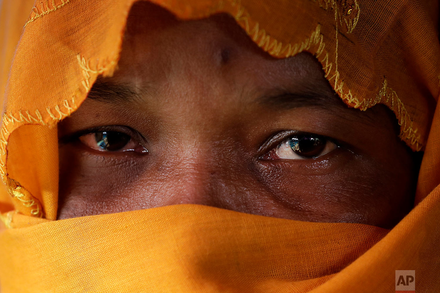 In this Wednesday, Nov. 22, 2017, photo, R, 28, mother of six, who says she was raped by members of Myanmar's armed forces in late August, is photographed in her tent in Kutupalong refugee camp in Bangladesh.  (AP Photo/Wong Maye-E)