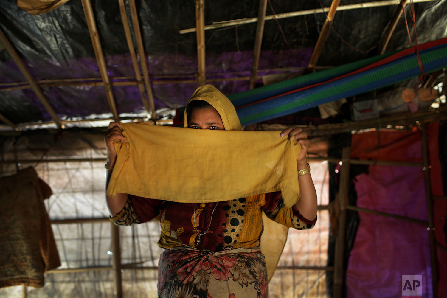 In this Tuesday, Nov. 21, 2017, photo, M, 25, mother of four, who says she was raped by members of Myanmar's armed forces in late August, is photographed in her tent in Kutupalong refugee camp in Bangladesh.  (AP Photo/Wong Maye-E)