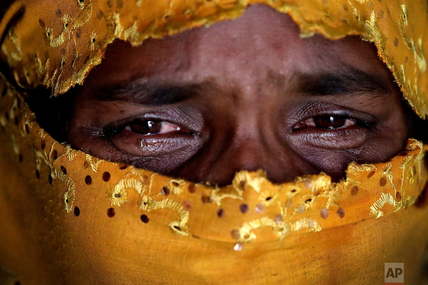 In this Tuesday, Nov. 21, 2017, photo, K, 25, right, cries as she recounts being gang raped by members of Myanmar's armed forces during an interview with The Associated Press in her tent in Kutupalong refugee camp in Bangladesh. (AP Photo/Wong Maye-E)