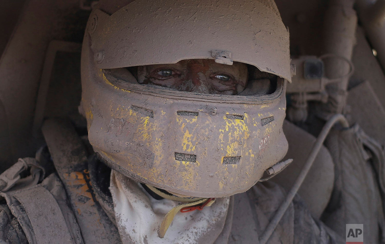Suzuki car driver Tim Coronel, of the Netherlands, is covered in dirt after completing the second stage of the Dakar Rally between Resistencia and San Miguel de Tucuman, Argentina, Tuesday, Jan. 3, 2017. The race started in Paraguay and passed through Bolivia as well. (AP Photo/Martin Mejia)