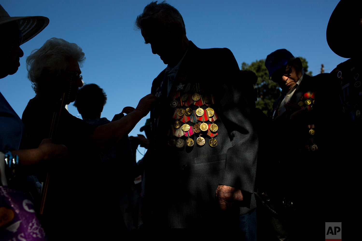 Russian-Israeli World War II veterans gather for  a street parade marking Victory Day, in Ashdod, Israel, Monday, May 8, 2017. Israeli World War II veterans from the former Soviet Union marched together with their families across the country Monday to celebrate the 72nd anniversary of the allied victory over Nazi Germany in 1945. (AP Photo/Oded Balilty)