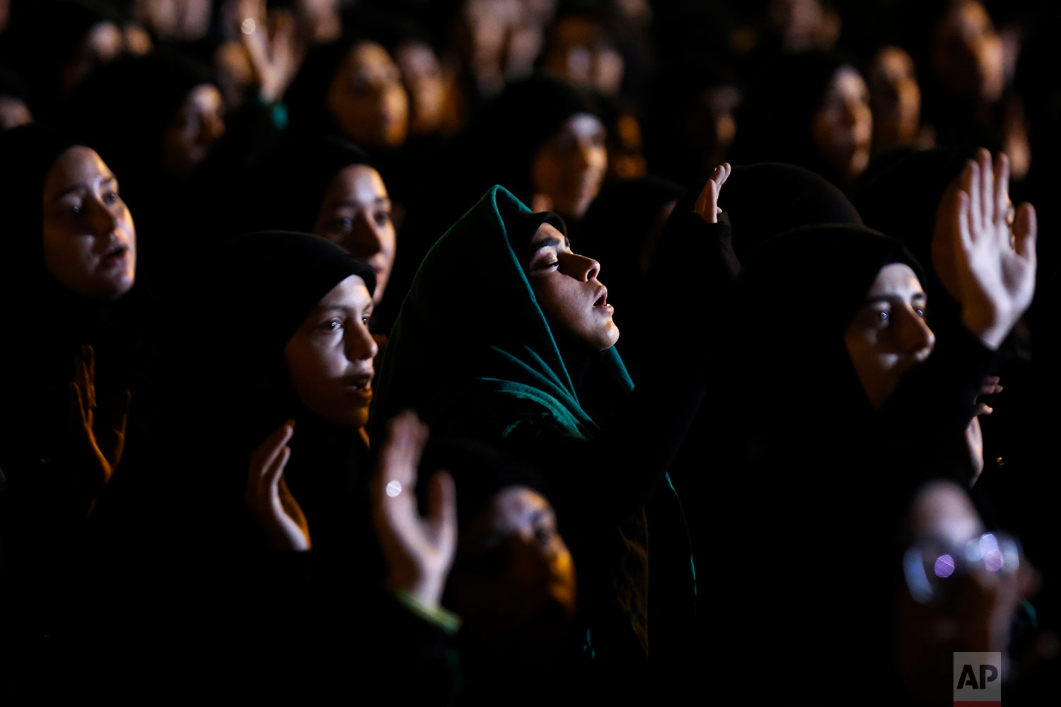 Hezbollah supporters listen to the story of Imam Hussein during activities to mark the ninth of Ashura, a 10-day ritual commemorating the death of Imam Hussein, in a southern suburb of Beirut, Lebanon, Saturday, Sept. 30, 2017. (AP Photo/Hassan Ammar)