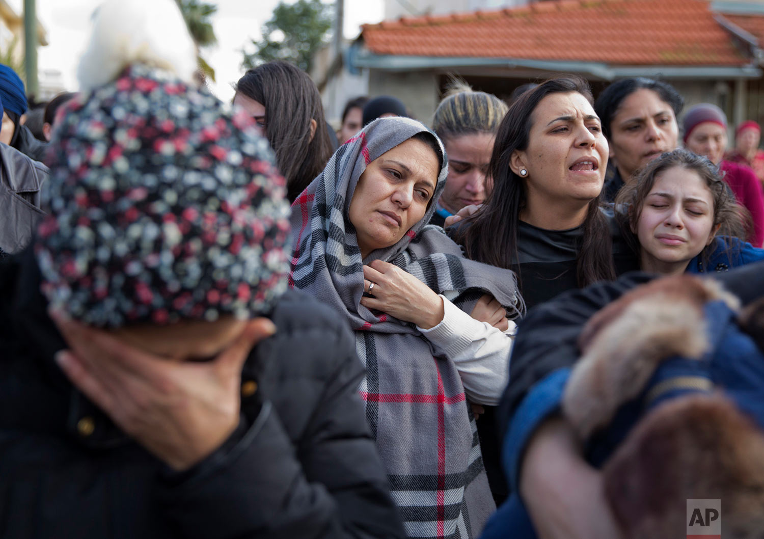 Lucy, mother of Leanne Nasser, center, mourns during the funeral of her daughter, who was killed in a New Year's Eve attack in Istanbul, in the town of Tira, Israel, Tuesday, Jan. 3, 2017. (AP Photo/Ariel Schalit)