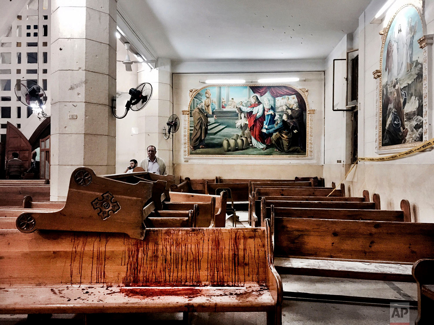 Blood stains pews inside the St. George Church after a suicide bombing, in the Nile Delta town of Tanta, Egypt, Sunday, April 9, 2017. Bombs exploded at two Coptic churches in the northern Egyptian cities of Tanta and Alexandria as worshippers were celebrating Palm Sunday, killing over 40 people and wounding scores more in assaults claimed by the Islamic State group. (AP Photo/Nariman El-Mofty)