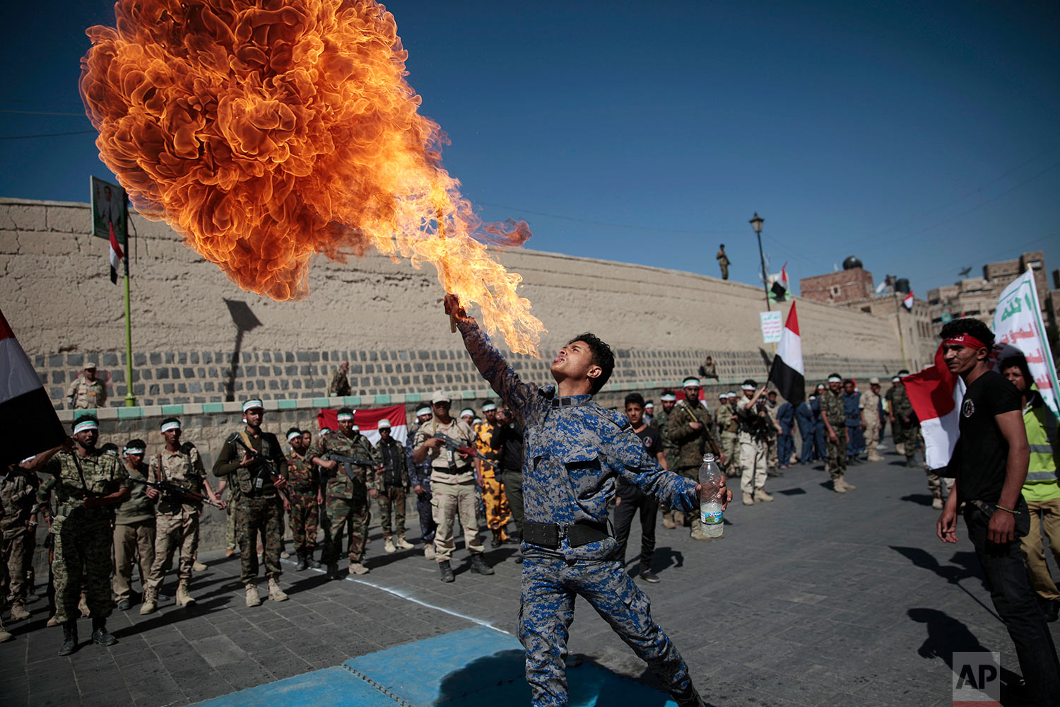 A newly recruited Shiite fighter, known as Houthi, displays his skills during a parade aimed at mobilizing more fighters into battlefronts to fight pro-government forces in several Yemeni cities, in Sanaa, Yemen, Thursday, Jan. 5, 2017. (AP Photo/Hani Mohammed)