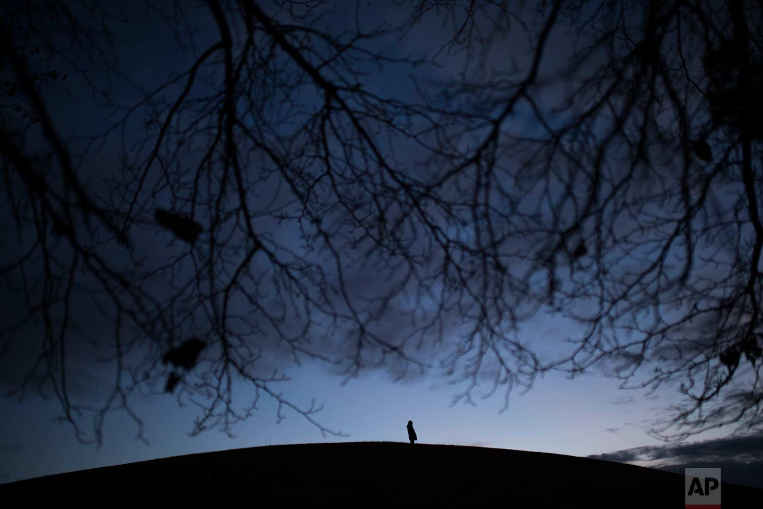 A man stands on top of a small hill at the Tio Pio park in Madrid, Monday, Dec. 11, 2017. (AP Photo/Francisco Seco)
