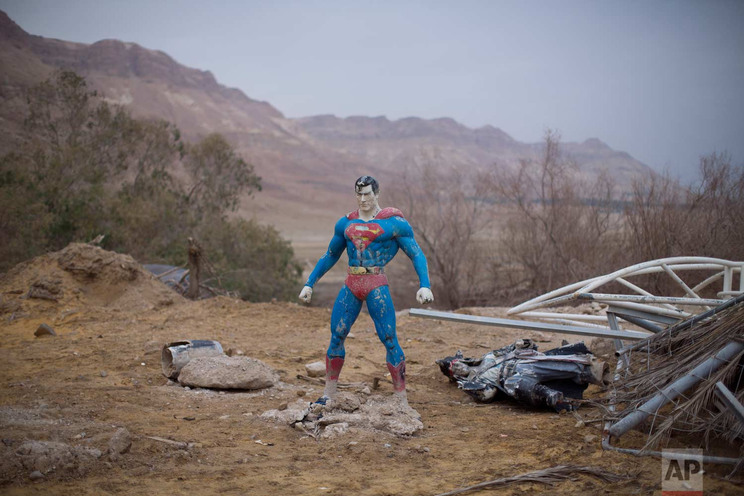 In this Wednesday, Jan. 25, 2017 photo, a superman statue is discarded at the Israeli Dead Sea resort of Ein Gedi. (AP Photo/Oded Balilty)