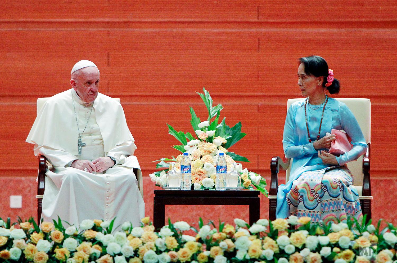 Myanmar's leader Aung San Suu Kyi talks to Pope Francis at a meeting in Naypyitaw, Myanmar, Tuesday, Nov. 28, 2017. (AP Photo/Aung Shine Oo)