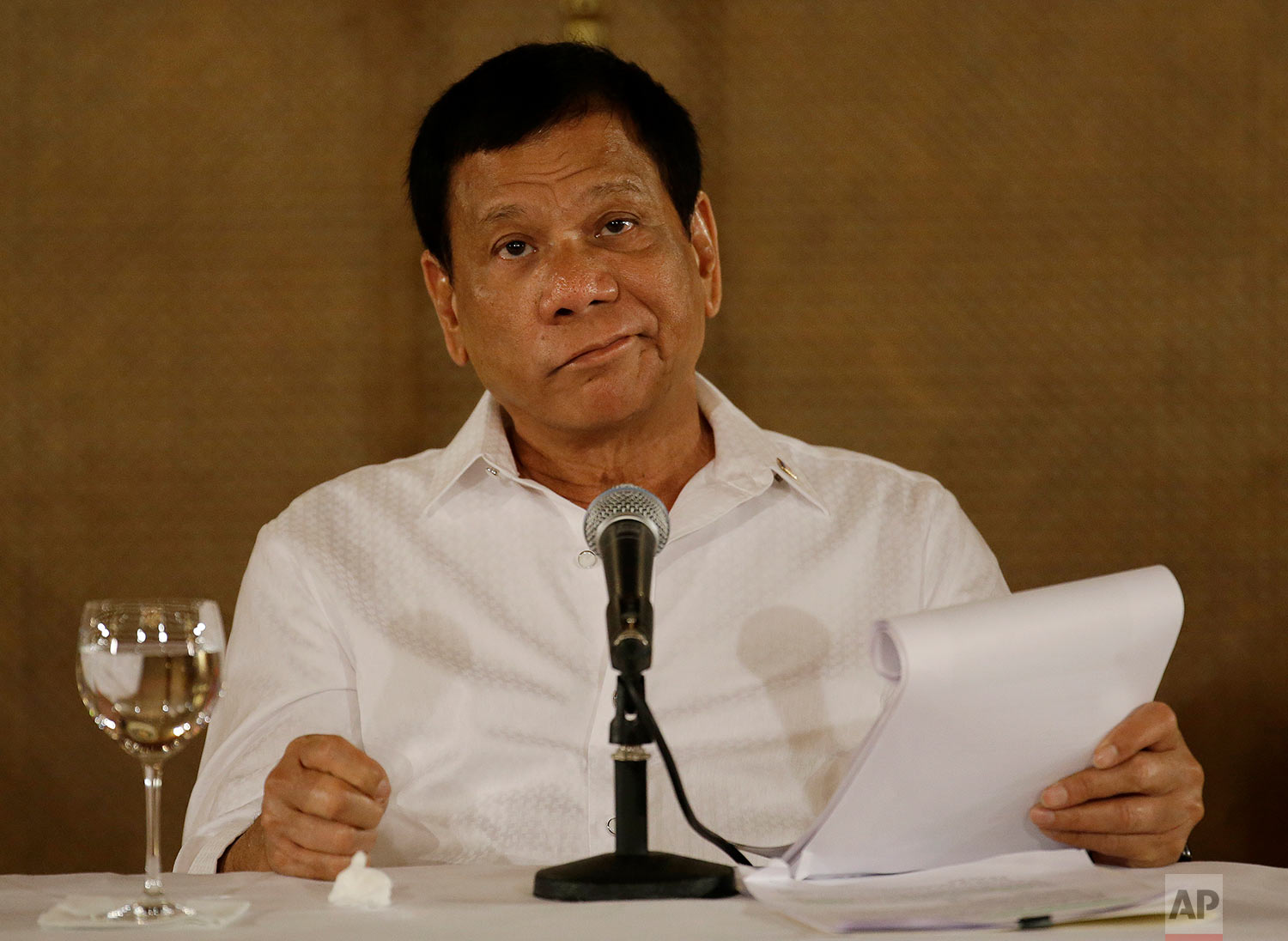Philippine President Rodrigo Duterte reacts during a press conference at the Malacanang presidential palace in Manila, Philippines on Monday, March 13, 2017. The Philippine president has ordered the military to assert his country's ownership of a vast offshore region off its northeastern coast where Chinese survey ships have been sighted last year and alarmed defense officials. (AP Photo/Aaron Favila)