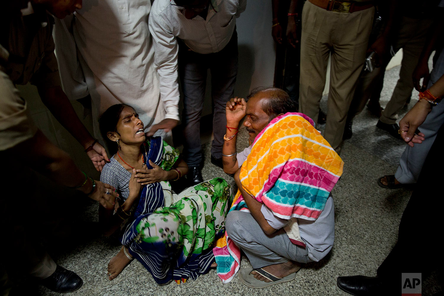 46-year-old Manthala weeps as she hears the news of the death of her one-month-old son Roshan at Baba Raghav Das Medical College Hospital in Gorakhpur, in the northern Indian state of Uttar Pradesh, Saturday, Aug. 12, 2017. Parents of at least 35 children who have died in the state-run hospital over the past three days have alleged that the fatalities were due to the lack of a sufficient oxygen supply in the children's ward. District Magistrate Rajiv Rautela said Saturday that the deaths of the children being treated for different ailments were due to natural causes. He denied that an insufficient oxygen supply led to their deaths. (AP Photo/Rajesh Kumar Singh)