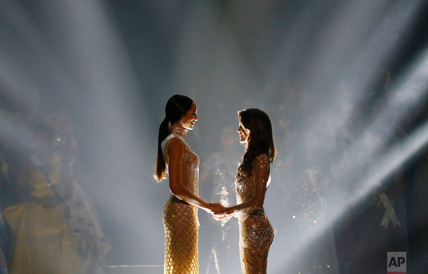 Iris Mittenaere of France, right, and Raquel Pelissier of Haiti hold hands moments before the winner was announced in the Miss Universe 2016 coronation Monday, Jan. 30, 2017, at the Mall of Asia in suburban Pasay city south of Manila, Philippines. Mittenaere was crowned the new Miss Universe 2016.(AP Photo/Bullit Marquez)