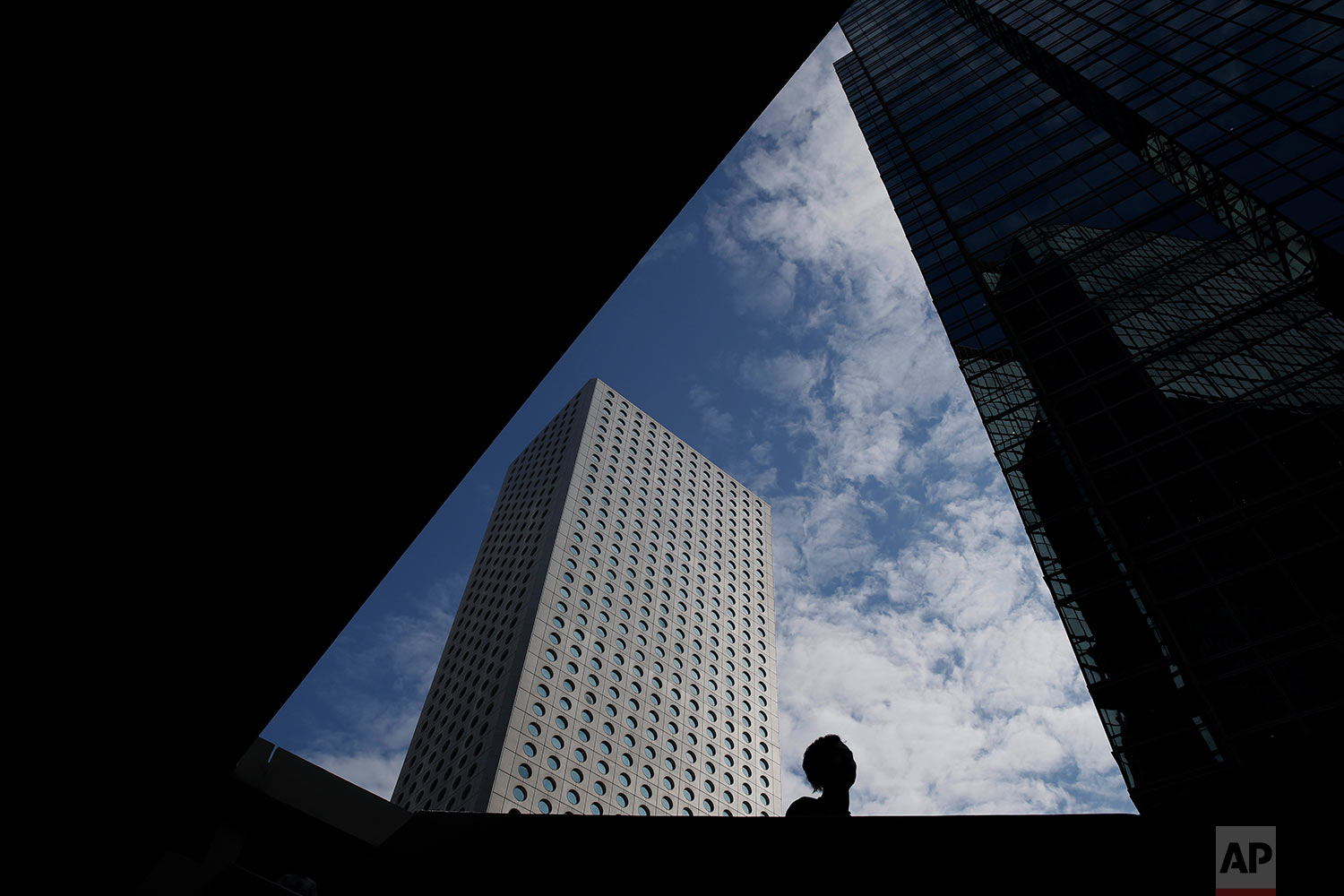 A man walks down the stairs in the Central, a business district of Hong Kong, Thursday, Nov. 9, 2017.  (AP Photo/Kin Cheung)