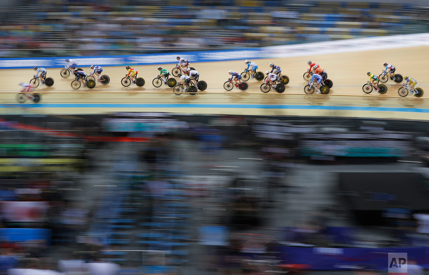 Riders compete in the Women's Scratch Race at the World Track Cycling championships in Hong Kong, Wednesday, April 12, 2017.  (AP Photo/Kin Cheung)