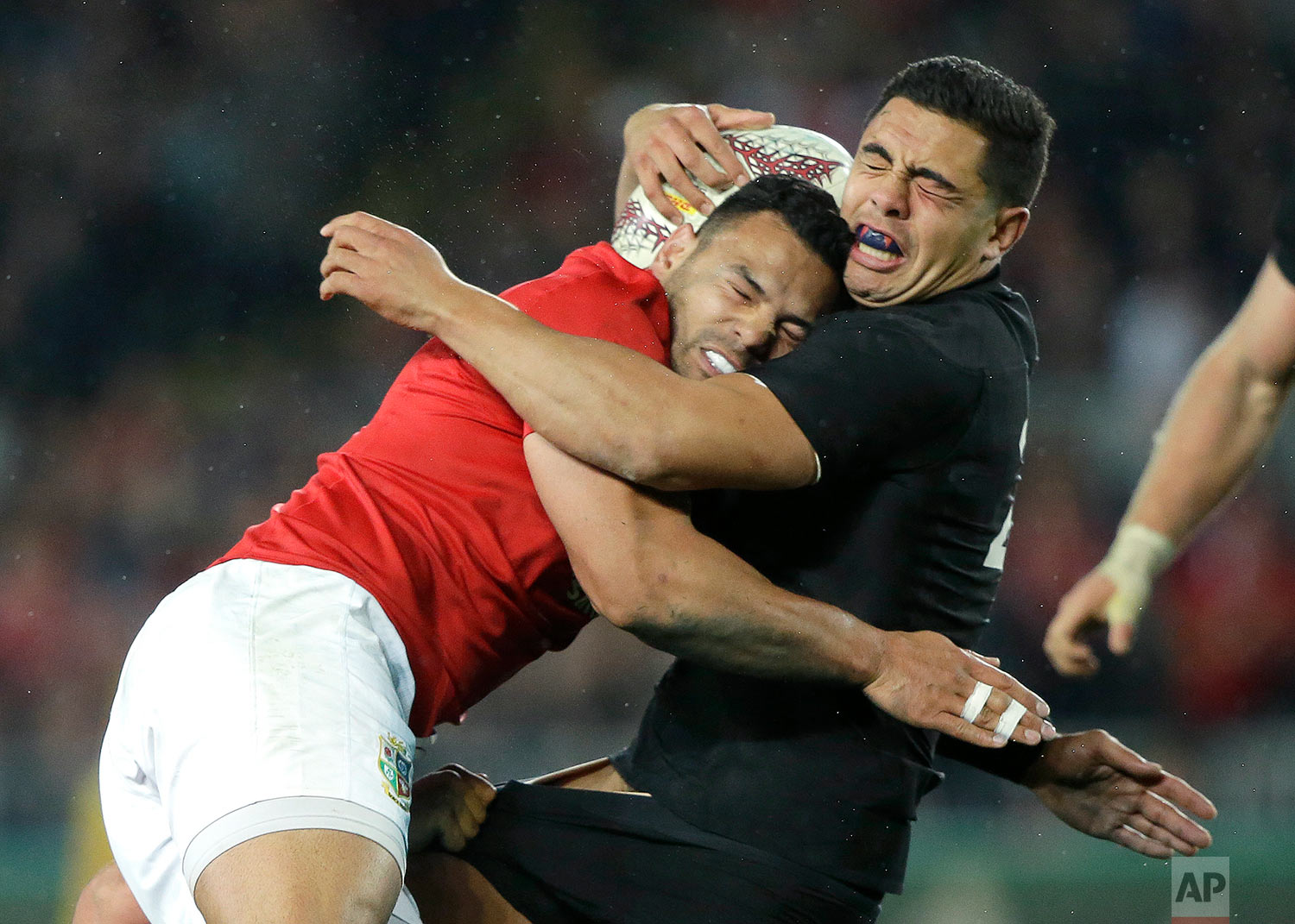 All Blacks centre Anton Linert-Brown, right, is tackled by British and Irish Lions Ben Te'o during the first test between the British and Irish Lions and the All Blacks at Eden Park in Auckland, New Zealand, Saturday, June 24, 2017. (AP Photo/Mark Baker)