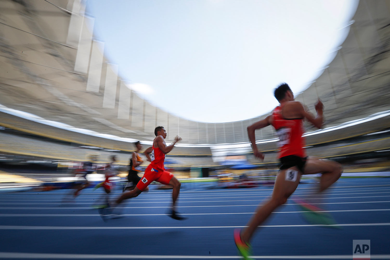 Runners compete during the Men's 400-meter semi-final at the 29th South East Asian Games in Kuala Lumpur, Malaysia, Thursday, Aug. 24, 2017. (AP Photo/Vincent Thian)