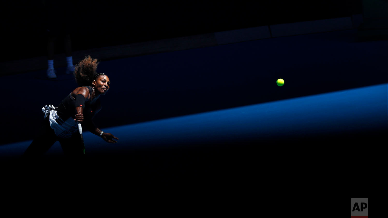 United States' Serena Williams serves to Britain's Johanna Konta during their quarterfinal at the Australian Open tennis championships in Melbourne, Australia, Wednesday, Jan. 25, 2017. (AP Photo/Kin Cheung)
