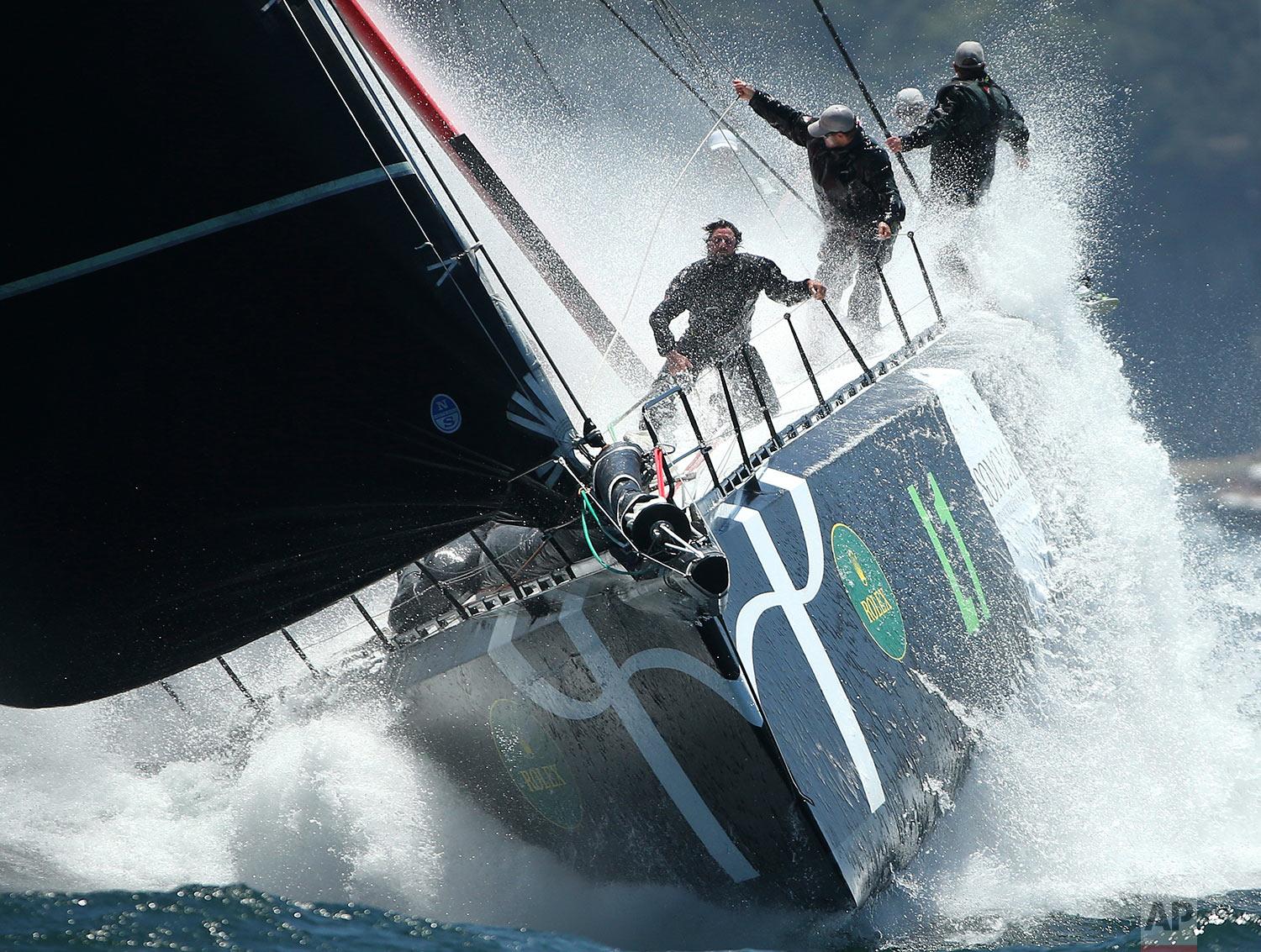 In this Monday, Dec. 26, 2016 photo, the yacht Loyal makes its way through the heads during the start of the Sydney Hobart yacht race in Sydney, Australia. The 88 yachts started in the annual 628-nautical mile race to Australia's island state of Tasmania. (AP Photo/Rick Rycroft)