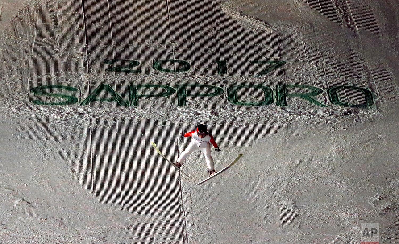 Japan's Naoki Nakamura soars through the air in his second round jump at the ski jumping men's large hill individual at the Asian Winter Games in Sapporo, northern Japan, Friday, Feb. 24, 2017.(AP Photo/Shuji Kajiyama)