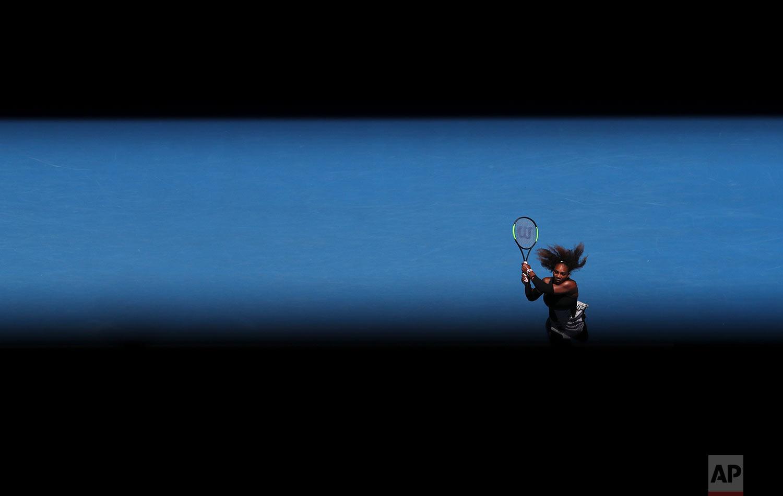 United States' Serena Williams makes a backhand return to Britain's Johanna Konta during their quarterfinal at the Australian Open tennis championships in Melbourne, Australia, Wednesday, Jan. 25, 2017. (AP Photo/Aaron Favila)