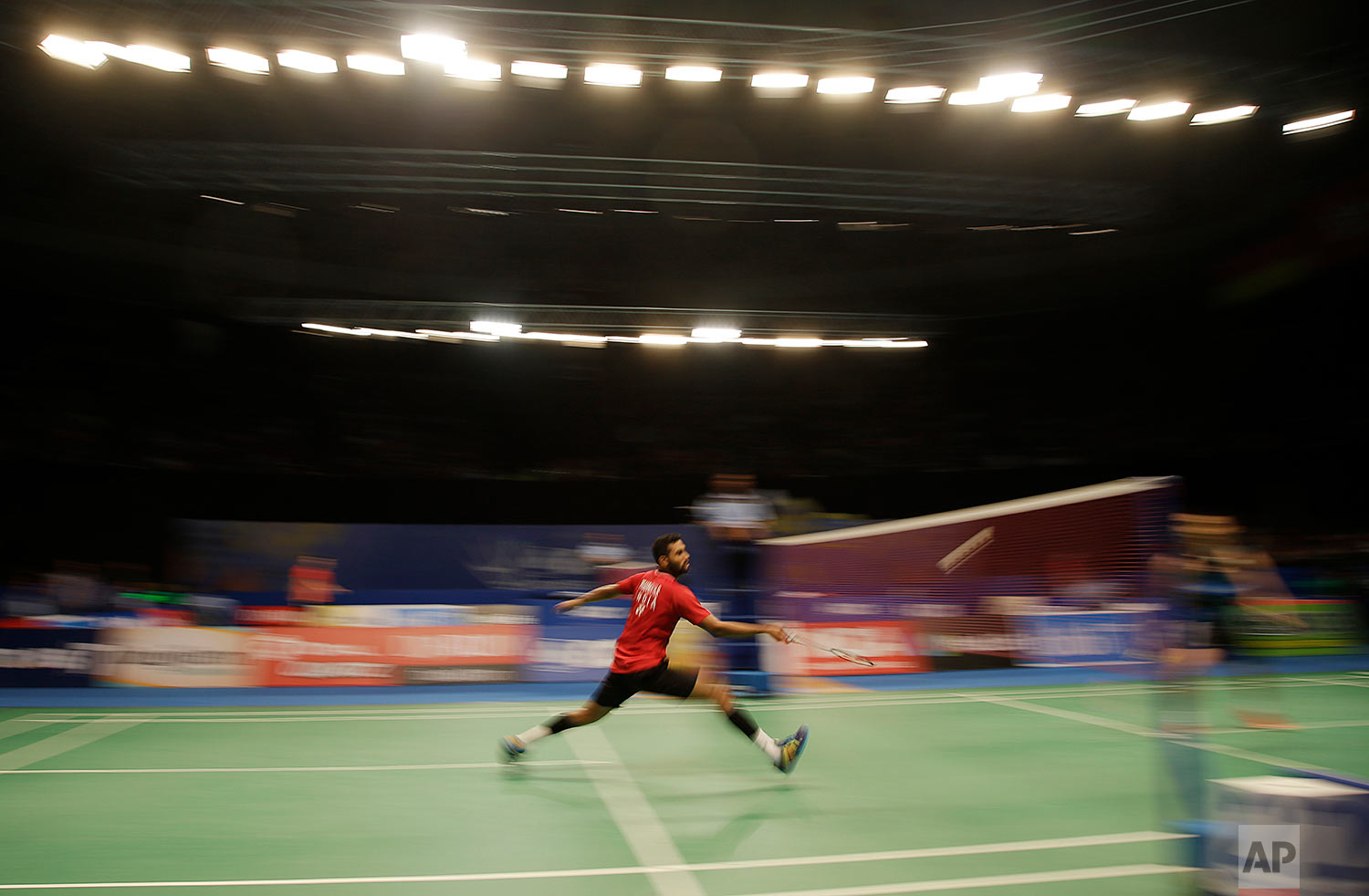 In this Thursday, June 15, 2017, photo, India's HS Prannoy plays against Malaysia's Lee Chong Wei during the second round of Indonesia Open badminton championship in Jakarta, Indonesia. (AP Photo/Dita Alangkara)