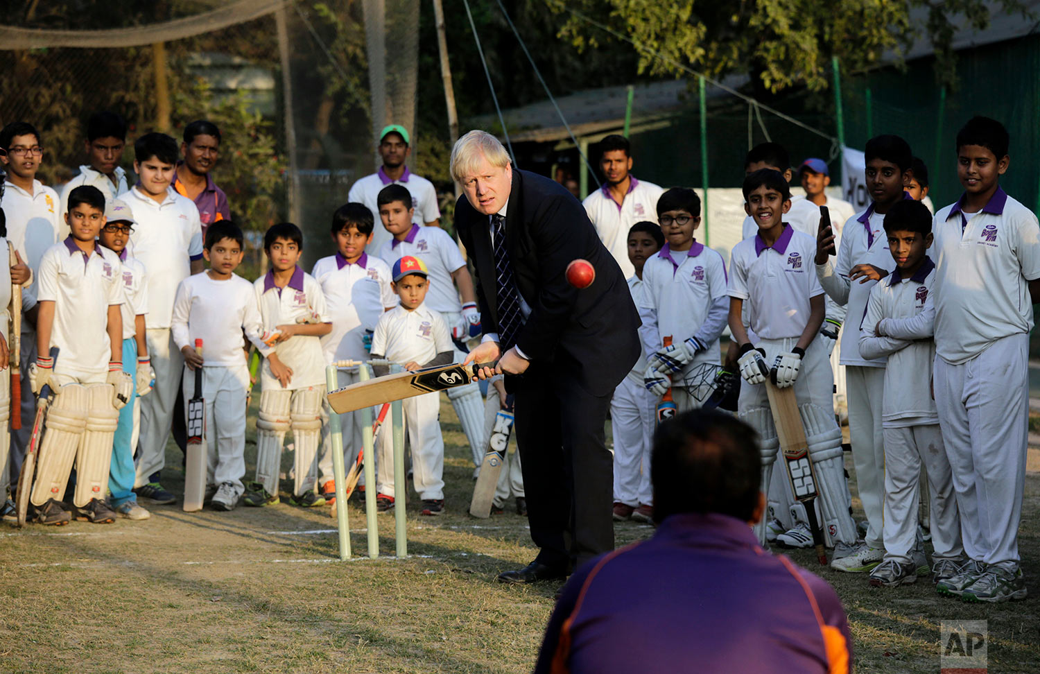 British Foreign Secretary Boris Johnson plays cricket at a cricket academy in Kolkata, India, Thursday, Jan. 19, 2017. Johnson, who is in India on a two-day visit, said Wednesday that his country would like to forge a free trade agreement with India as it prepares to leave the European Union. (AP Photo/Bikas Das)