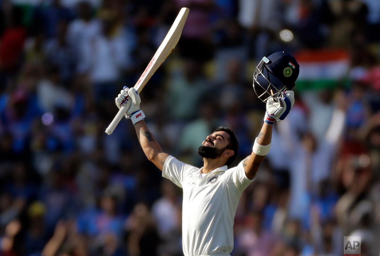 In this Nov. 26, 2017, photo, India's captain Virat Kohli looks skywards as he celebrates scoring double century during the third day of their second test cricket match against Sri Lanka in Nagpur, India. (AP Photo/Rajanish Kakade)