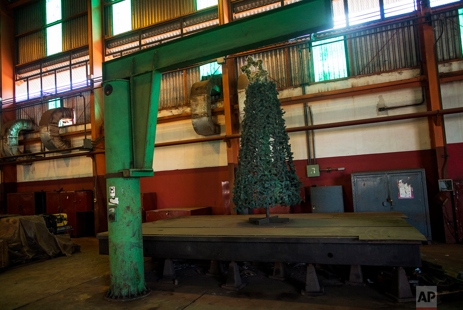 In this Nov. 3, 2017 photo, a Christmas tree decorates the Pellas steel plant in Ciudad Guayana, Bolivar state, Venezuela. Years of neglect and mismanagement have left in decay Ciudad Guayana, a once-thriving would-be Pittsburgh carved from the jungles in the 1950s. (AP Photo/Rodrigo Abd)