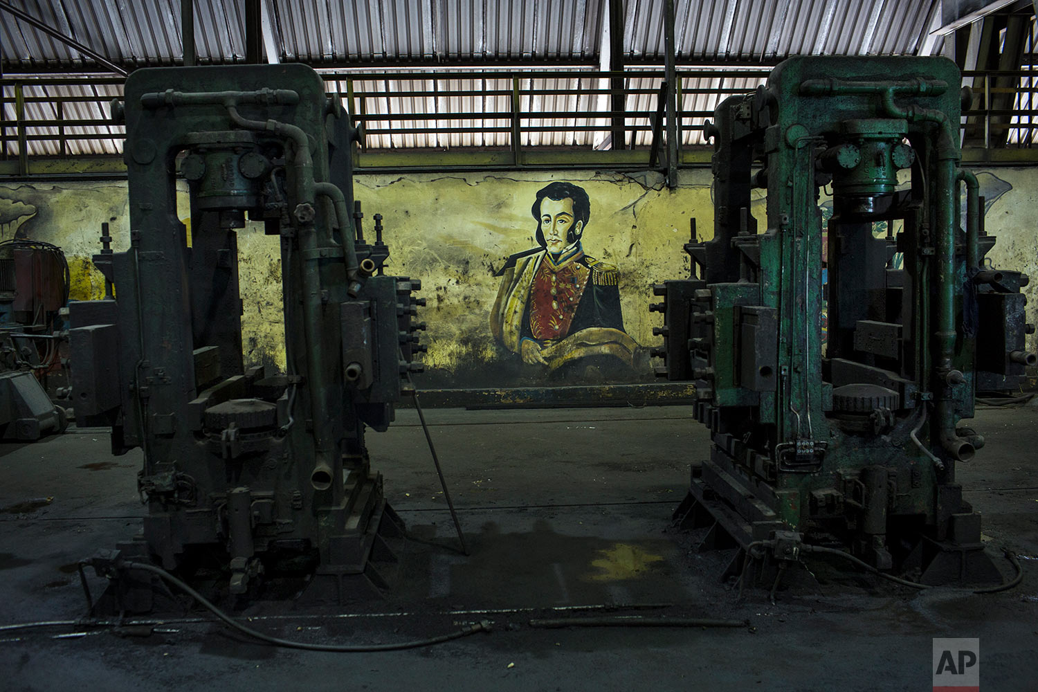 In this Nov. 7, 2017 photo, a painting of Latin America's independence hero Simon Bolivar, is seen at Sidor's Alambron plant, in Ciudad Guayana, Bolivar state, Venezuela. Production this year at state-run Sidor, Venezuela's largest steelmaker, is expected to reach barely 20 percent of what was peak production in 2007. (AP Photo/Rodrigo Abd)