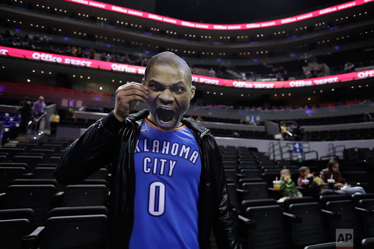 Basketball fan David Martinez, of Monterrey, poses with a cardboard cutout of Oklahoma City Thunder's player Russell Westbrook before a regular-season NBA basketball game against the Brooklyn Nets in Mexico City, Thursday, Dec. 7, 2017. (AP Photo/Rebecca Blackwell)