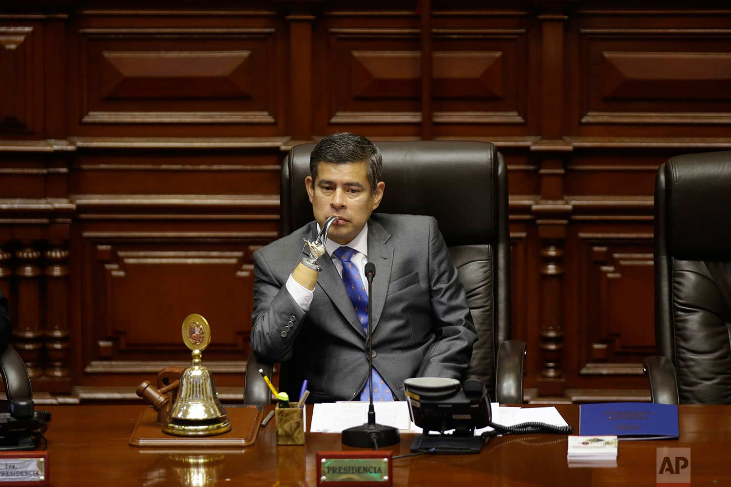 National Congress President Luis Galarreta presides over a special session on whether to initiate impeachment proceeding against the country's president, in Lima, Peru, Friday, Dec. 15, 2017. (AP Photo/Martin Mejia)