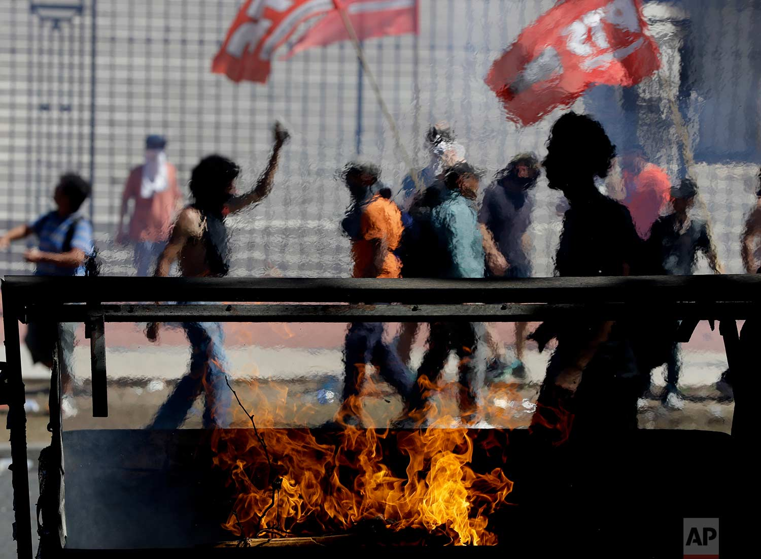 Demonstrators protest against reforms to the retirement and pension system, in Buenos Aires, Argentina, Thursday, Dec. 14, 2017. (AP Photo/Natacha Pisarenko)