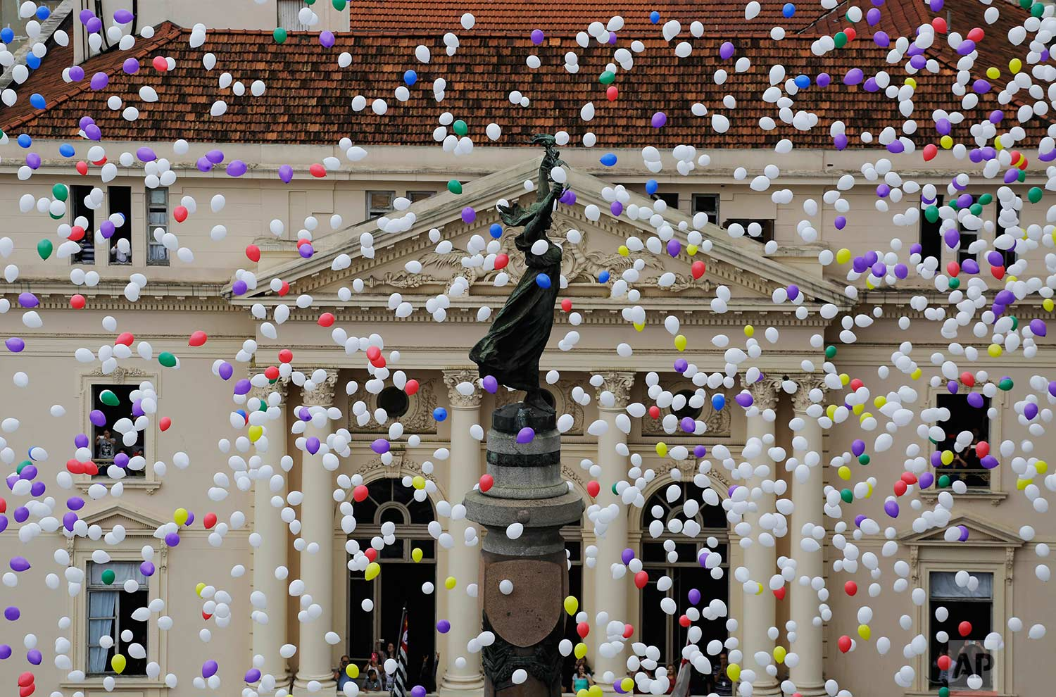 Members of Sao Paulo's Commerce Association release fifty thousand balloons to celebrate the New Year in Sao Paulo, Brazil, Friday, Dec. 29, 2017. (AP Photo/Nelson Antoine)