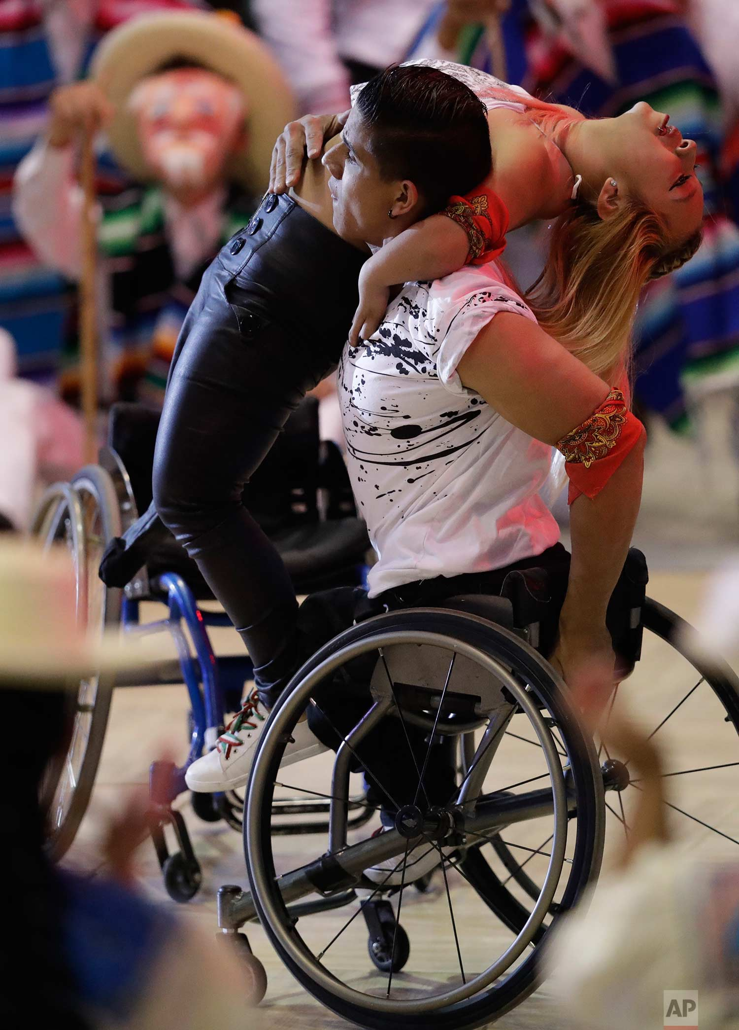 Dancers in wheelchairs perform during the opening ceremony of the World Para Swimming and Para Powerlifting Championships in Mexico City, Saturday, Dec. 2, 2017. (AP Photo/Rebecca Blackwell)