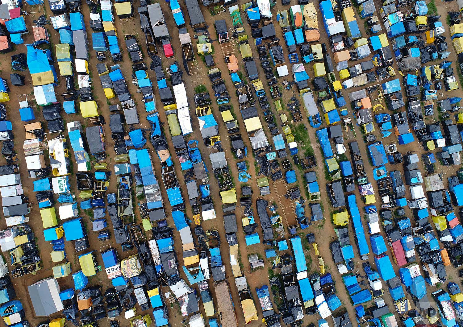 """In this Tuesday, Dec. 12, 2017 photo, lines of improvised homes create the squatter community coined """"Povo Sem Medo,"""" or Fearless People, in Sao Bernardo do Campo, a suburb of Sao Paulo, Brazil. (AP Photo/Andre Penner)"""