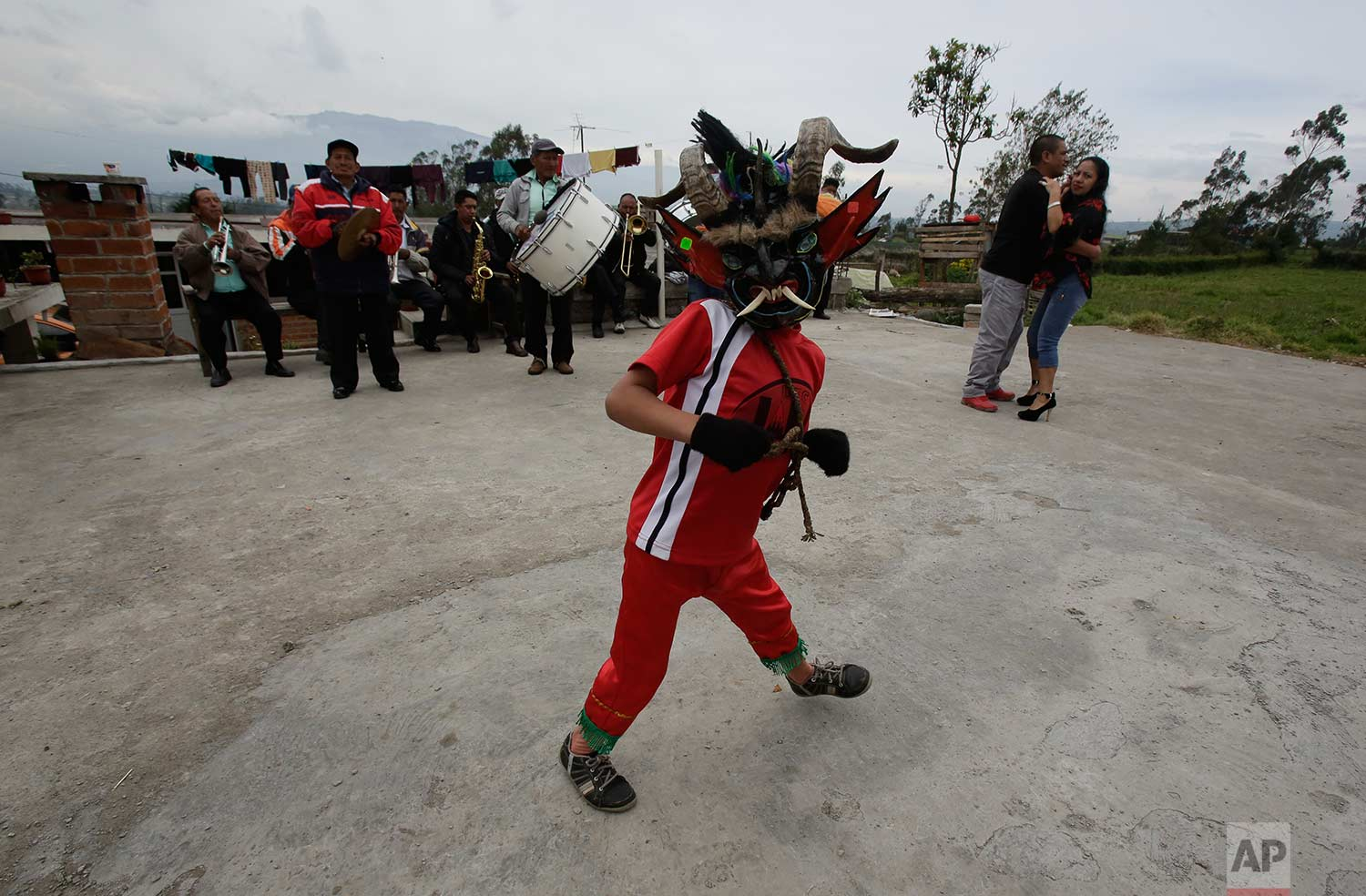 "A man wearing a devil mask dances during the traditional New Year's festival known as ""La Diablada"", in Pillaro, Ecuador, Friday, Jan. 5, 2018. (AP Photo/Dolores Ochoa)"