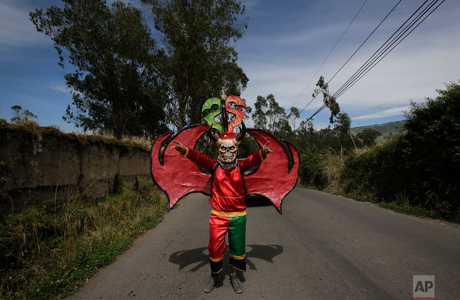 "Dressed for the traditional New Year's festival known as ""La Diablada"", a participant strikes a pose in Pillaro, Ecuador, Friday, Jan. 5, 2018. (AP Photo/Dolores Ochoa)"