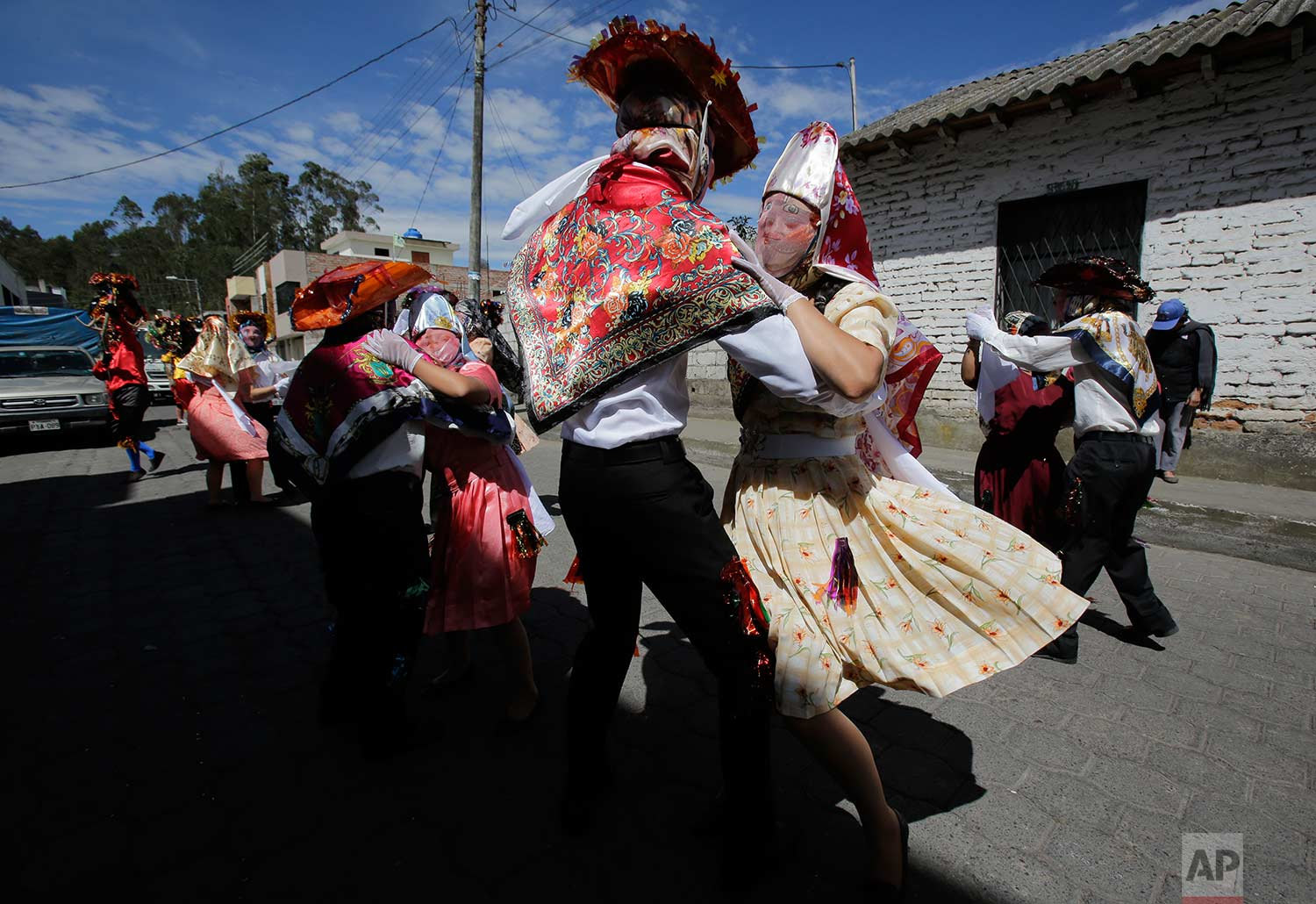 "Couples representing the more affluent line dance during the traditional New Year's festival known as ""La Diablada"", in Pillaro, Ecuador, Friday, Jan. 5, 2018. (AP Photo/Dolores Ochoa)"