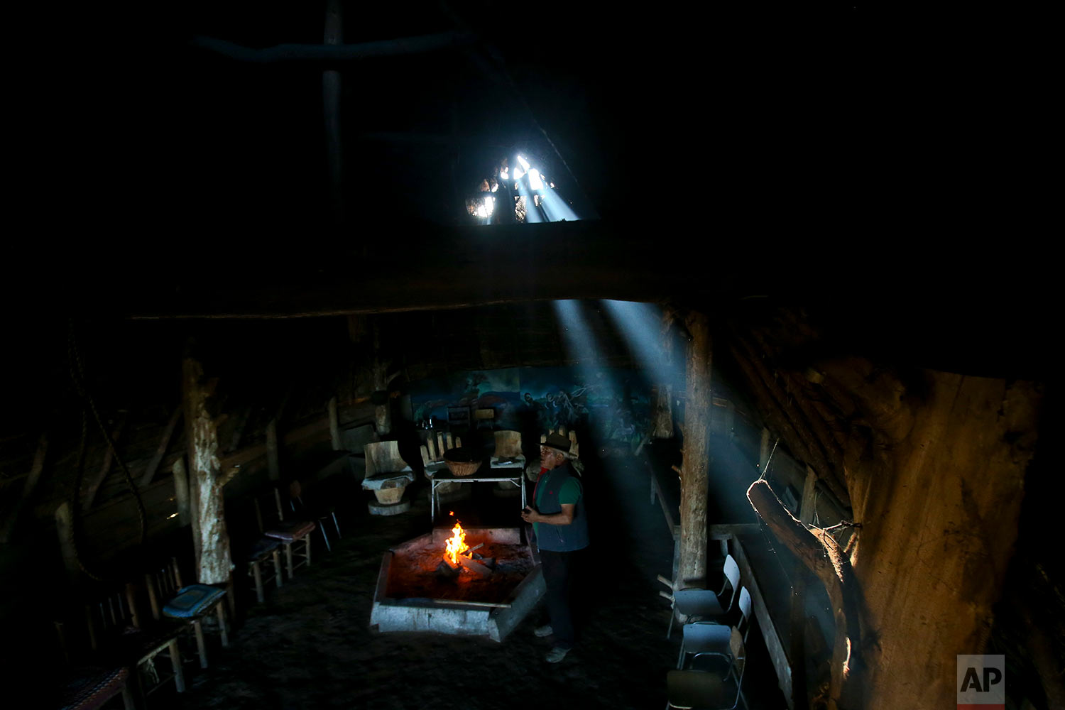 In this Sunday, Jan. 7, 2018 photo, Mauricio Painefil readies a traditional house known as a ruca for tourists, in the Mapuche community Llaguepulli, in Temuco, Chile. The Mapuche are successfully introducing ethno-turismo, sharing their ancestral traditions and culture. (AP Photo/Esteban Felix) | See these photos on AP Images
