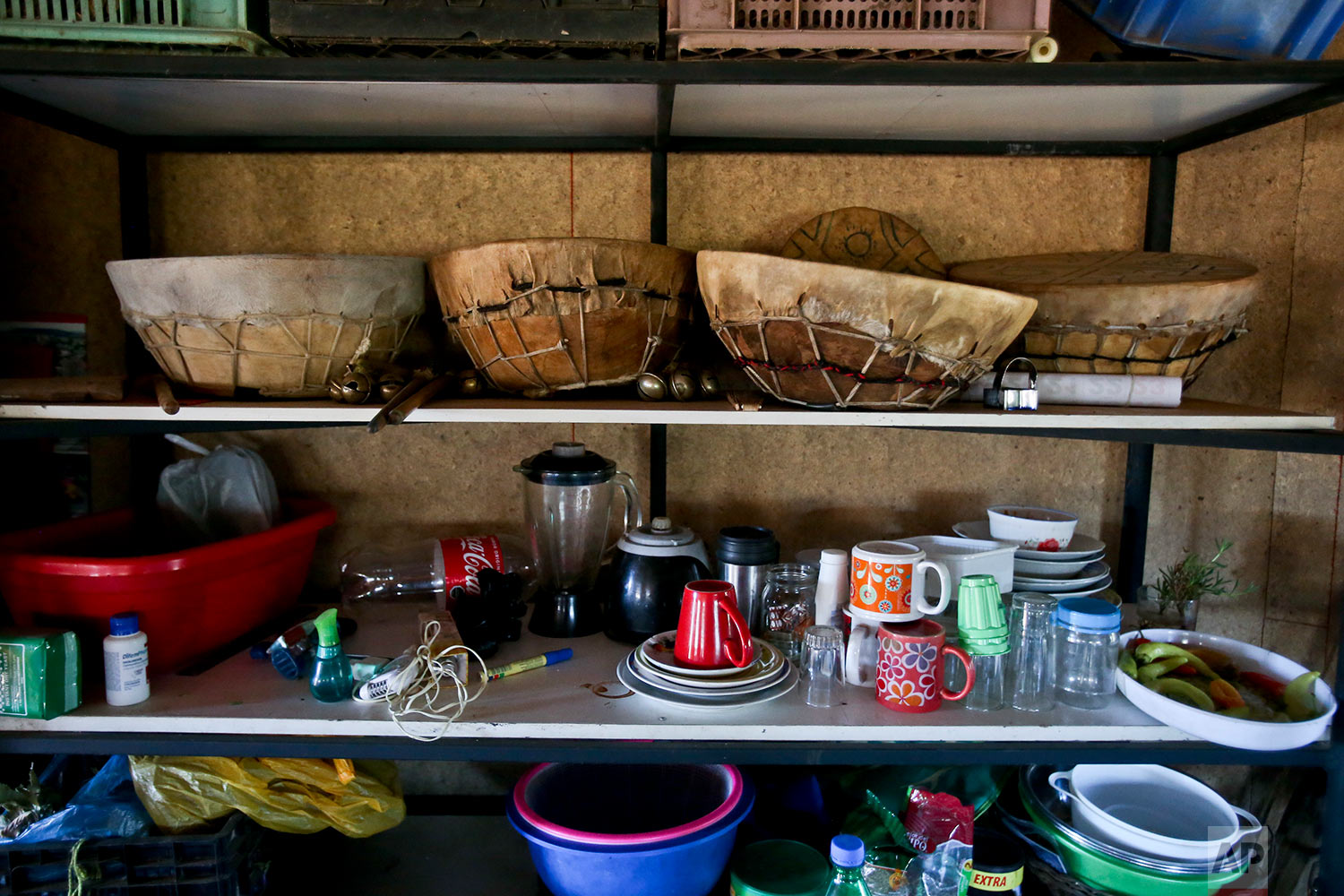 """This Monday, Jan. 8, 2018 photo shows ceremonial Mapuche drums, known as kulbruns, stored on a kitchen shelf in the home of Kallfurayen Llanquileo, a healer and religious leader known as a Machi, in the Mapuche community Enoco, in Temuco, Chile. """"In practical terms, we as a people don't exist. It's shameful,"""" said the president of ENAMA, a Mapuche group that encourages local businesses and advocates social change. (AP Photo/Esteban Felix) 
