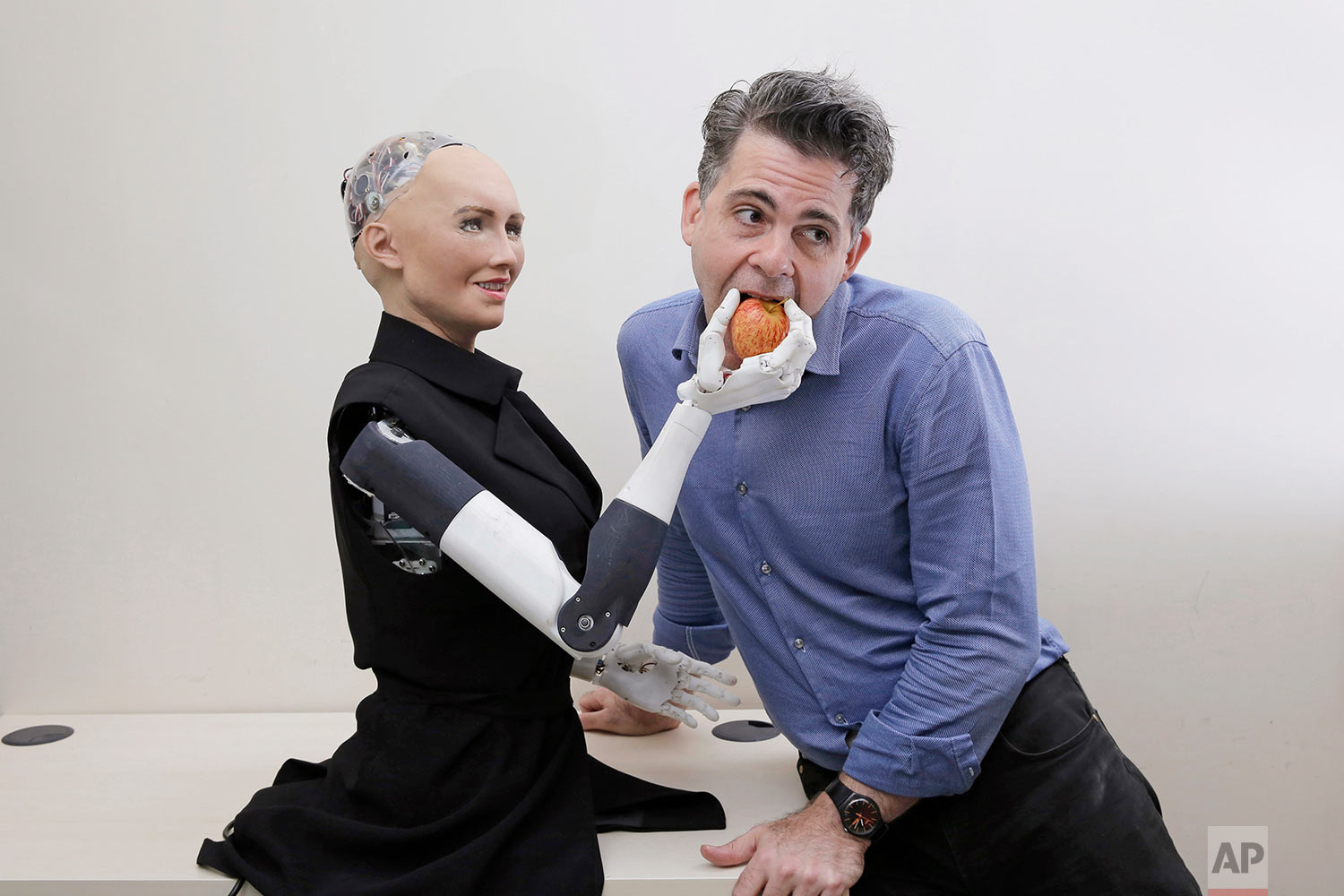 In this Sept. 28, 2017, photo, David Hanson, the founder of Hanson Robotics, poses with his company's flagship robot Sophia, a lifelike robot powered by artificial intelligence in Hong Kong. (AP Photo/Kin Cheung) |  See these photos on AP Images