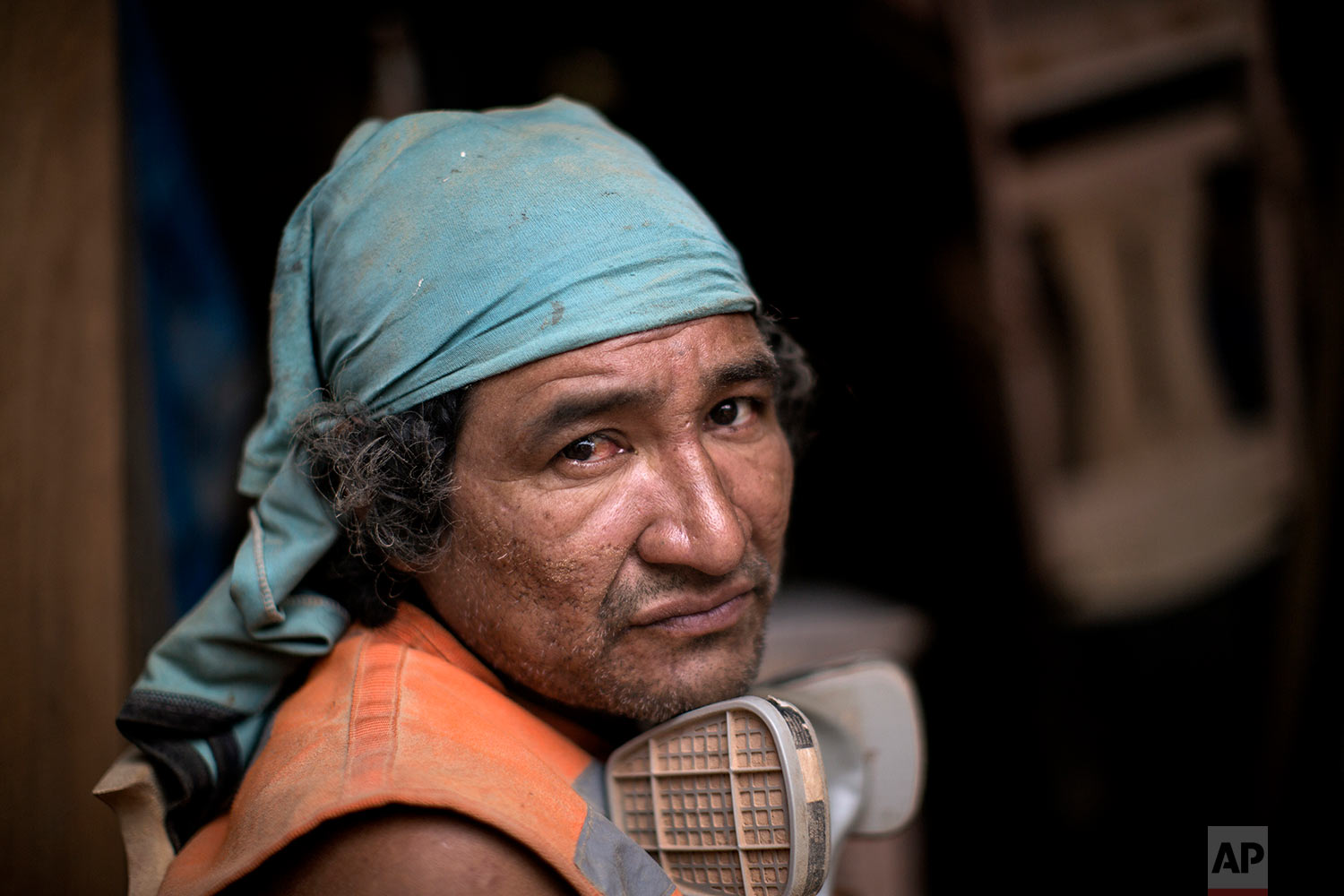 In this Jan. 12, 2018 photo, inmate Roy Ruiz Flores, 44, pauses for a portrait as he rests from building chairs to be used during the visit by Pope Francis to Puerto Maldonado, Madre de Dios province, Peru. Prisoners convicted of crimes like robbery and drug trafficking at this prison in the Peruvian Amazon are using their time behind bars to build simple wooden chairs that indigenous leaders will use while meeting with Pope Francis. (AP Photo/Rodrigo Abd)| See these photos on AP Images
