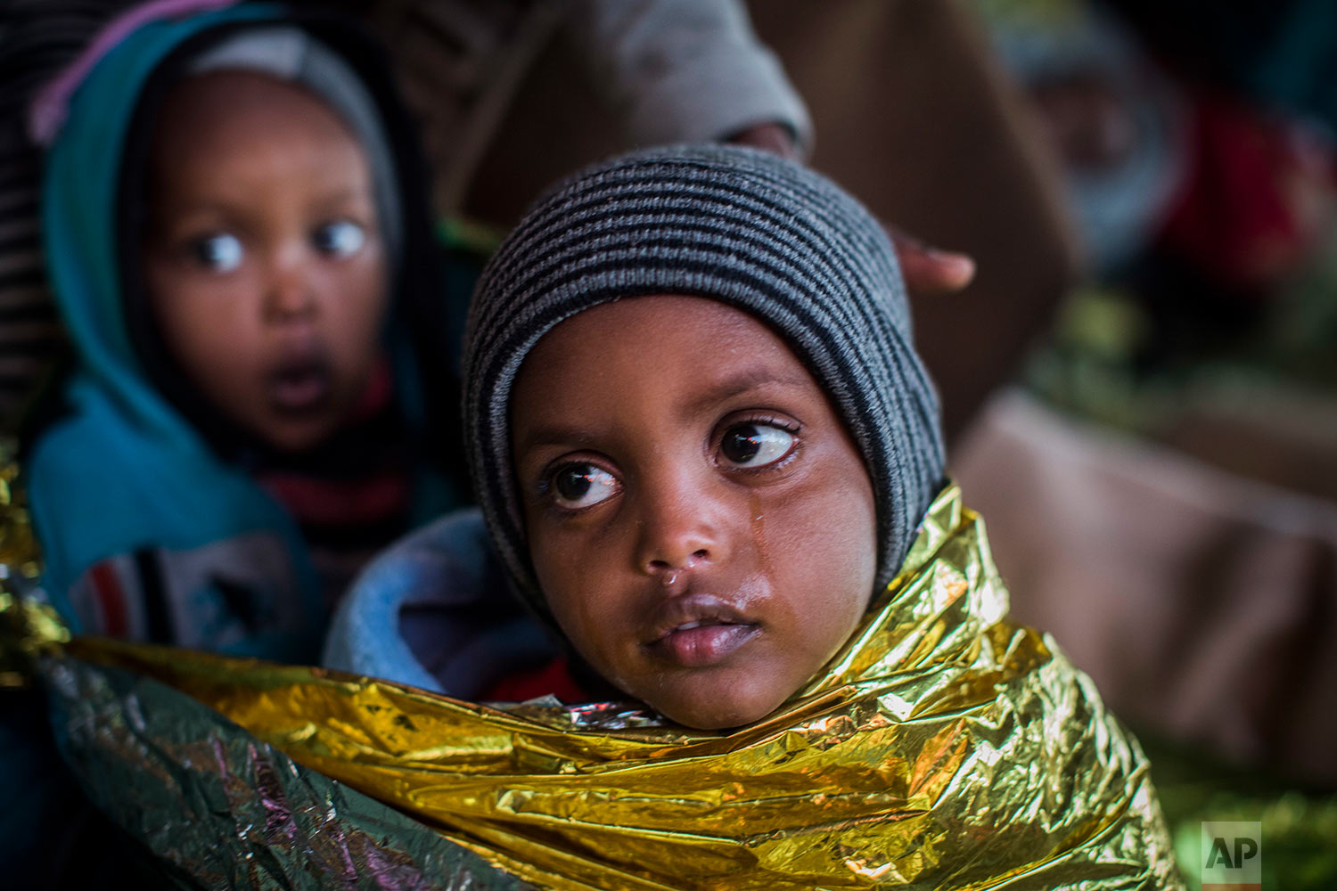 In this Friday, Jan. 19, 2018 photo children from Eritrea rest on board the Spanish NGO Proactiva Open Arms rescue ship as the vessel heads to the Italian port of Pozzallo, in Sicily. (AP Photo/Santi Palacios)