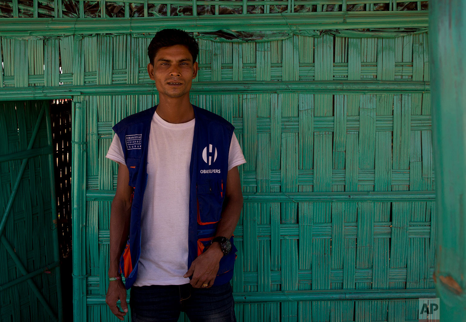 """In this Tuesday, Jan. 23, 2018, photo, Mohammad Younus, 30, who is second time refugee poses for a photograph at BaluKhali refugee camp 50 kilometres (32 miles) from, Cox's Bazar, Bangladesh. Younus says """"The Buddhists were torturing us, beating us and cutting us up. My parents couldn't take it so they came here."""" (AP Photo/Manish Swarup)  See these photos on AP Images"""