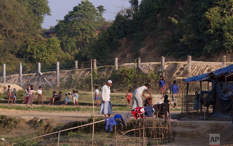 In this Tuesday, Jan. 23, 2018, photo, Rohingya refugees are seen next to the Bangladesh Myanmar border at Tumru, near Cox's Bazar, Bangladesh.(AP Photo/Manish Swarup)  See these photos on AP Images