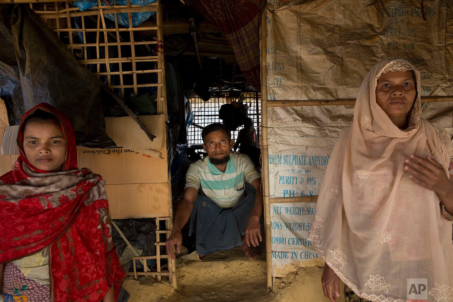 In this Tuesday, Jan. 23, 2018, photo, Abdul Gaffar, 50, who has repatriated two times, sits in his small kiosk at BaluKhali refugee camp 50 kilometers (32 miles) from, Cox's Bazar, Bangladesh, Tuesday, Jan. 23, 2018. (AP Photo/Manish Swarup)   See these photos on AP Images