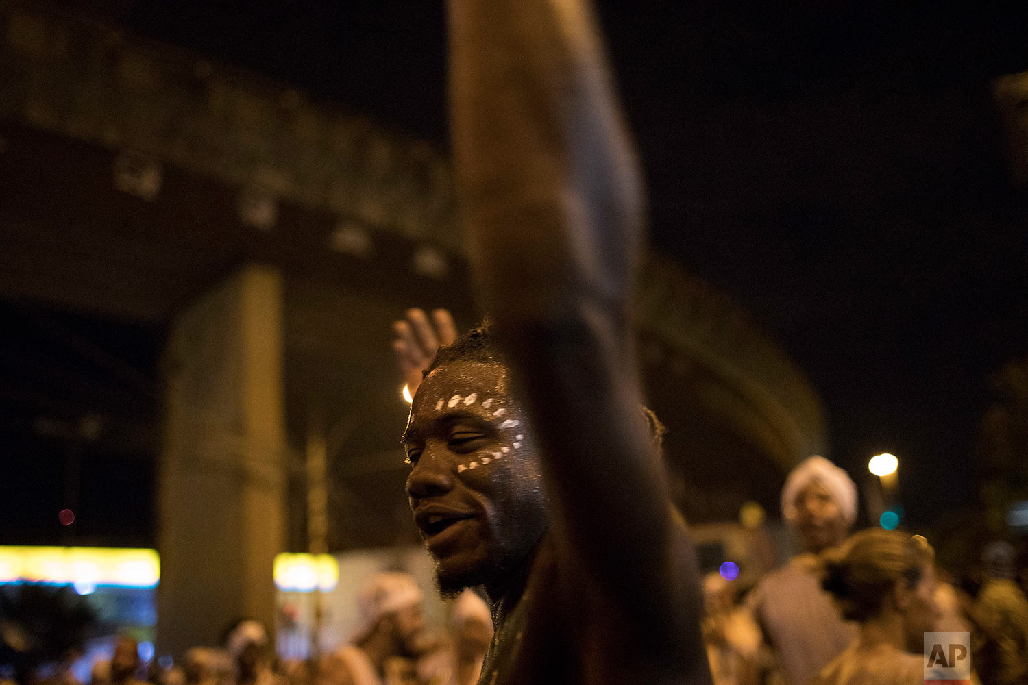 """In this Jan. 22, 2018 photo, a member of the Paraiso do Tuiuti samba school rehearses their dances and songs that make reference to Brazil's history with slavery, in the streets of Rio de Janeiro, Brazil. Leaders of the samba group see many instances of what they consider """"modern-day slavery"""" in Latin America's largest nation. (AP Photo/Leo Correa)"""