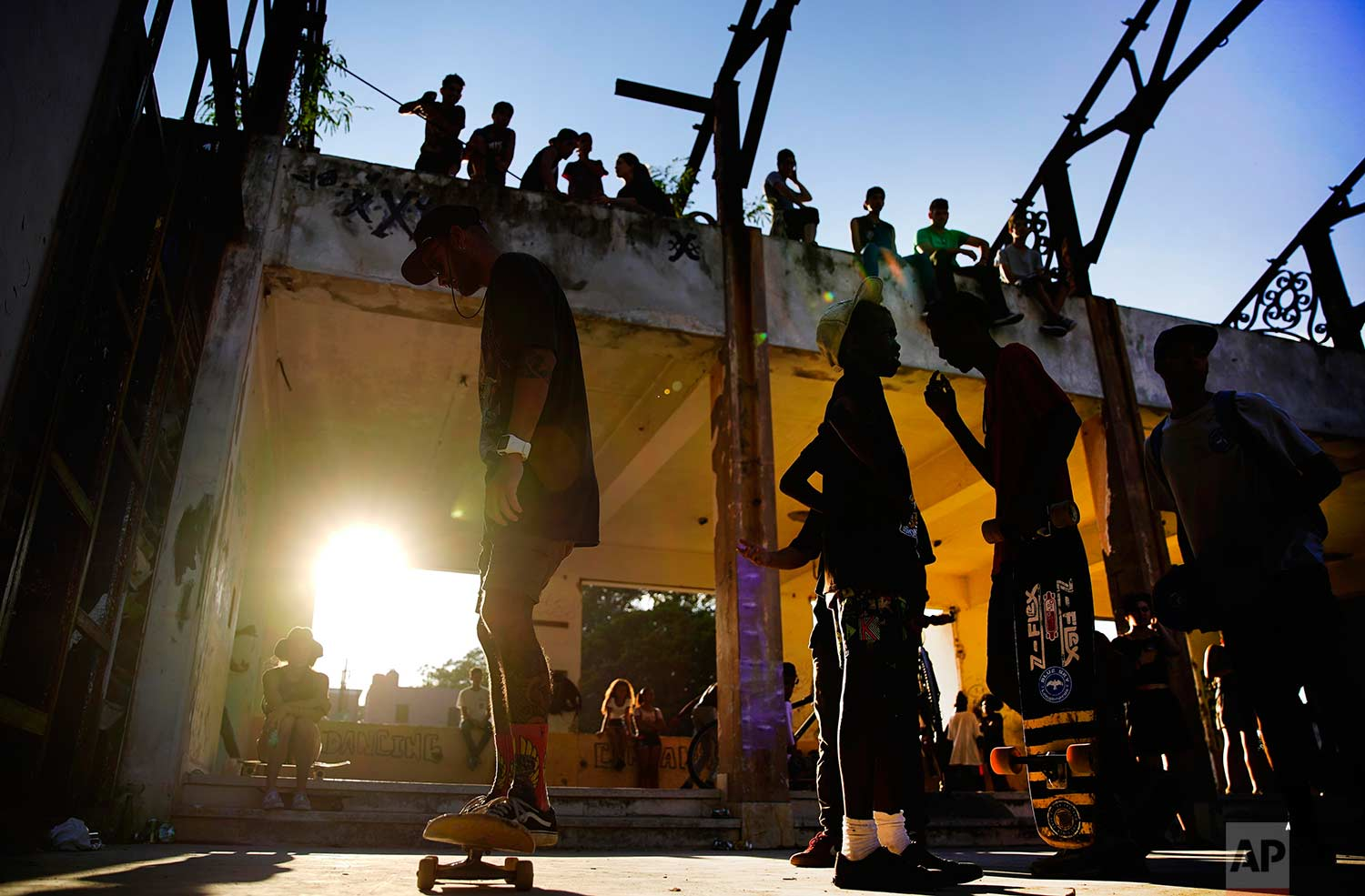 In this Jan. 11, 2018 photo, skaters gather for the inauguration of a new recreational space for skateboarders, created in an abandoned gym at the Educational complex Ciudad Libertad, a former military barracks that the late Fidel Castro turned into a school complex after the revolution in Havana, Cuba. (AP Photo/Ramon Espinosa)